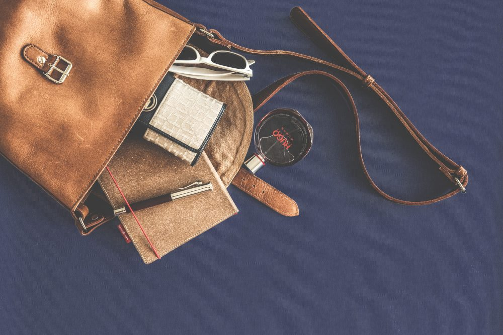Empty Your Handbag Travel Hacks Pack Light