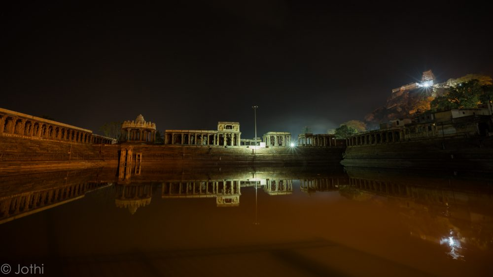 Temple Tank With Yoga Narasimha Swamy Temple In The Background