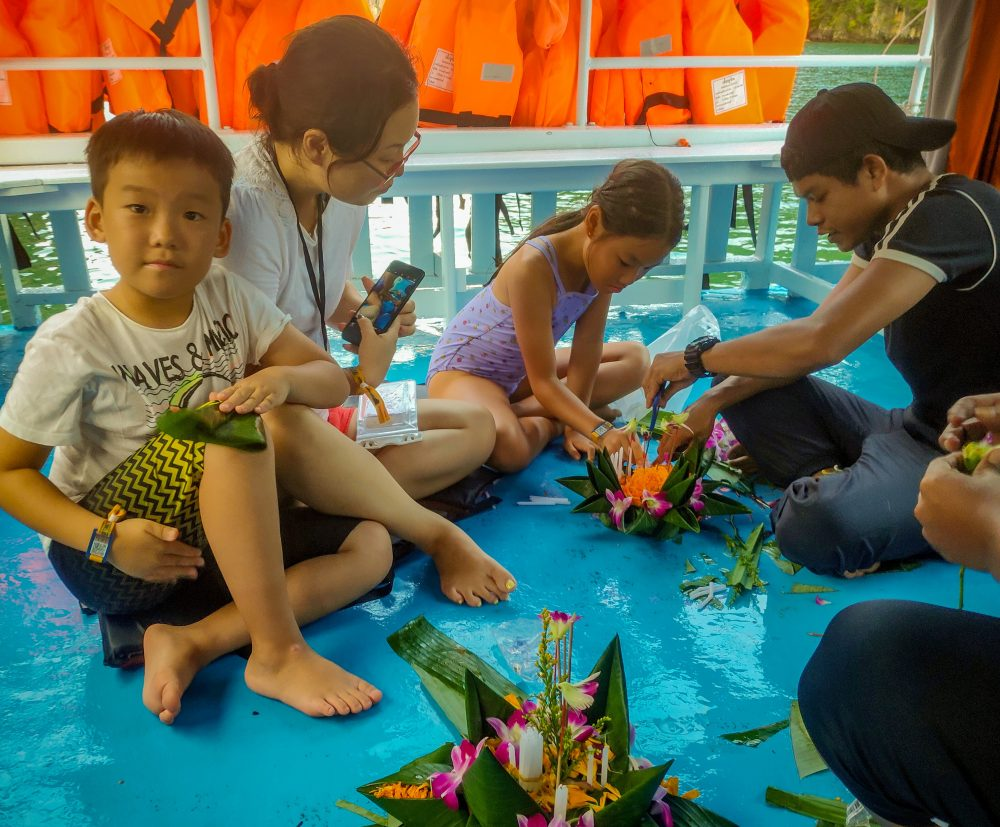 A Family From Hong Kong Crafting Their Krathong Thailand